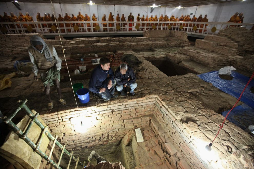 """""""The excavations showed that older wooden structures lay beneath the walls of the later brick Buddhist shrine. The layout of that more recent shrine duplicates the layout of the earlier wooden structures, pointing to a continuity of Buddhist worship at the site."""" (NG)"""